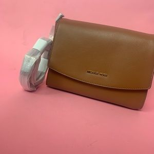 Authentic Michael Kors luggage crossbody